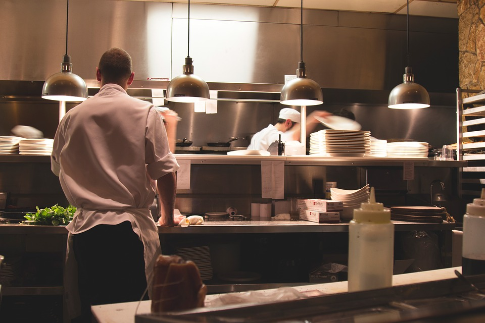 chefs cooking food in the kitchen